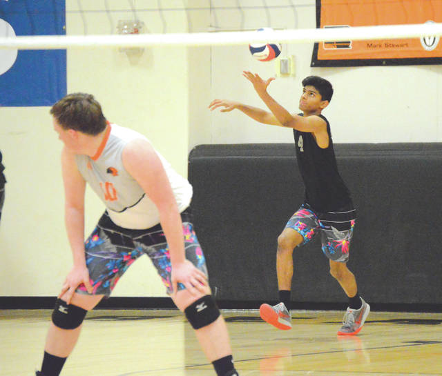 Naumaan Hussain (4) prepares to serve in an April 3 boys high school volleyball battle between state-ranked teams. Hussain and the No. 6-ranked Beavercreek Beavers defeated visiting No. 9 Northmont in four sets.