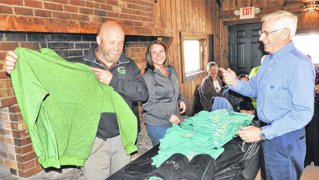 As one of four volunteers serving more than 600 hours, GCP&T Volunteer Ken Bish, far right, is honored with a GCP&T commemorative sweatshirt. Bish serves as the Russ Nature Reserve Volunteer Coordinator, is an active trail sentinel and assists with several GCP&T special events.