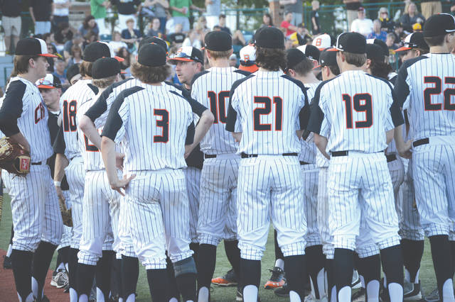 Beavercreek coach Brandon Long (center left) talks to his team before their final at-bat, in Saturday's May 19 Division I sectional final contest with Centerville, at Nischwitz Stadium in Fairborn.
