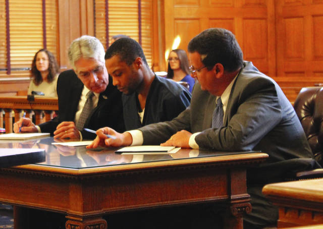 Anna Bolton | Greene County News Attorneys William Mooney and John Cornely look over a copy of an indictment with defendant Michael McLendon (center) May 4 in Greene County Common Pleas Court.