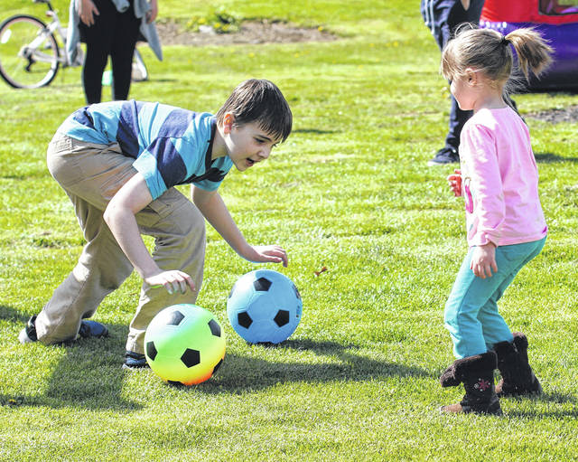 Barb Slone | Greene County News Beavercreek Parks, Recreation & Culture Department hosted a summer kick off event for children at Dominick Lofino Park April 21. Chidlren could enjoy food, games, inflatables and learn more about the parks programs at the event.
