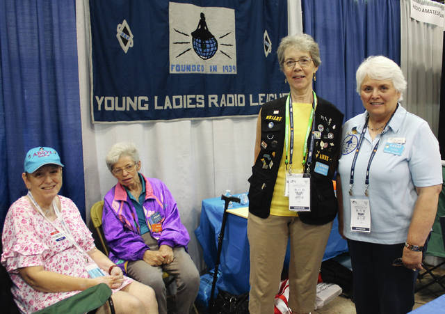 Anna Bolton | Greene County News Sallie Howard, AB5YL, Texas; Hope Smith, WB3ANE, Florida; Anne Manna, WB1ARU, Massachusetts and Carol Laferty, K4SAF, Kentucky represented the Young Ladies Radio League at Hamvention May 18.