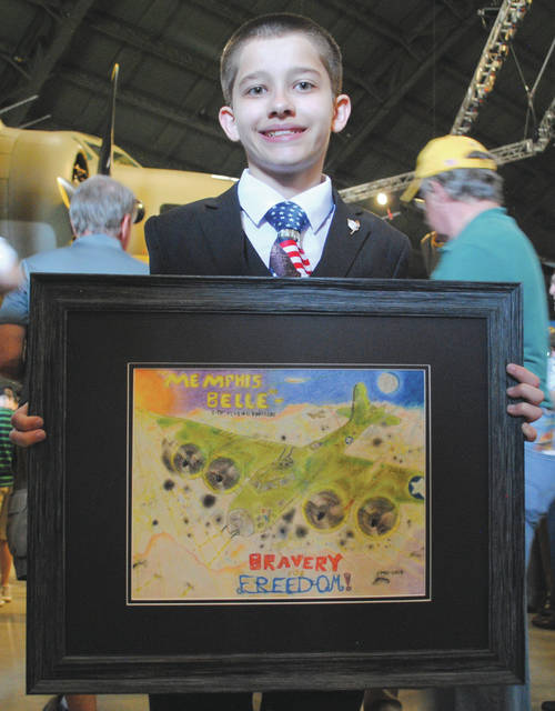 Joshua Cahoon, 12, winner of the student art contest hosted by the National Museum of the United States Air Force.