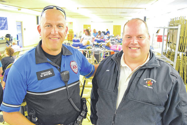 Submitted photo Beavercreek Police Officer Mark Brown and Beavercreek Township Fire Chief David Vandenbos are ready to challenge their departments to give blood.