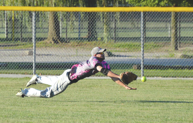These guys take this game serious. Here a member of the Pristine Finishes outfield makes a diving try at a sinking fly ball, July 6 on Rotary Park's Diamond 4 in Beavercreek.