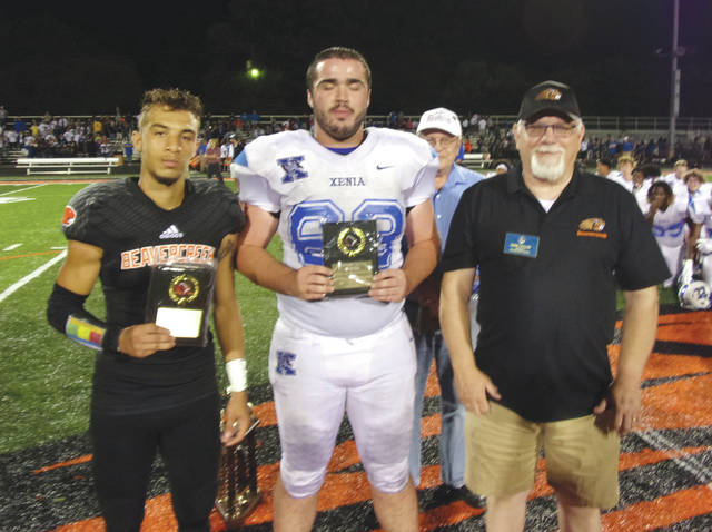Submitted photos Beavercreek's Maurice Wilson (left) and Xenia's Peyton Bartley were named the Backyard Battle's Special Teams Players of the Game, and presented their awards by Beavercreek Kiwanis Club President Gene Taylor, Aug. 24 at Beavercreek High.