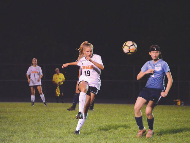 Senior midfielder Kenedy Spalla, of Beavercreek, lofts a pass around Fairborn's junior midfielder Hannah Baumgardner, in the first half of Wednesday's Greater Western Ohio Conference crossover game at the Fairborn Soccer Stadium.
