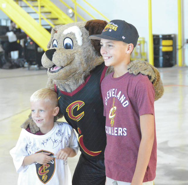 Kids enjoyed posing with Moondog of the Cleveland Cavaliers at Sunday's Sept. 30 Wine & Gold basketball scrimmage at the Wright-Patterson Air Force Base.