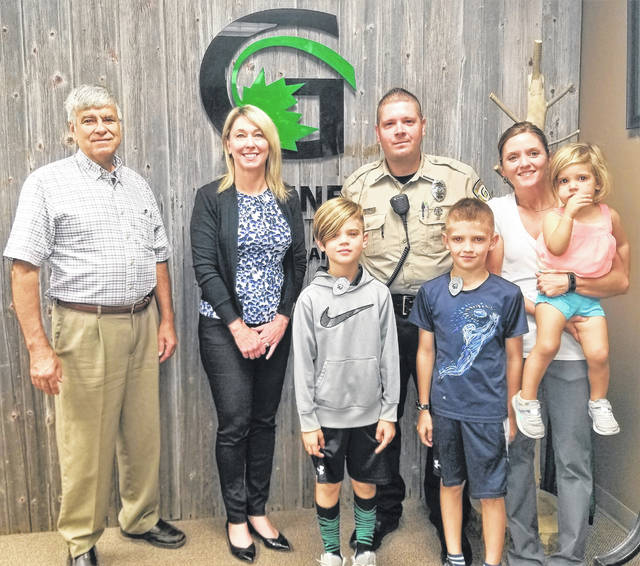 Greene County Park District Vice President Tony Sculimbrene and Greene County Park District Commissioner Michelle Jenkins visit with new GCP&T Ranger Tim Fouts and his family before the park board meeting.