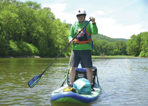 Submitted photo Peter Savard, a doctoral nursing student, paddle boarded down the Susquehanna River to raise awareness for clean water for people in need.