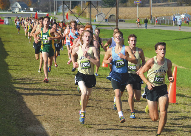 John Bombatch | Greene County News Runners head down the final straight during the 2017 OHSAA state cross country championships at National Trail Raceway in Hebron. The 2018 event has been postponed due to flooding at the famed drag strip.