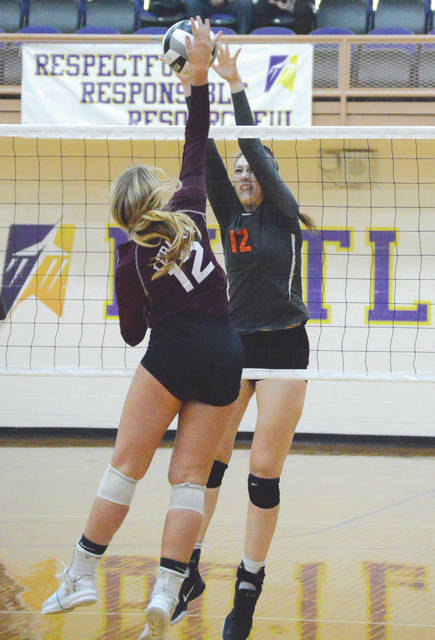 Sophomore outside hitter Anna Shoemake of Beavercreek blocks a shot by Lebanon's Josie Cropper in a Division I girls volleyball sectional final, Oct. 24 at the Student Activities Center at Butler High School in Vandalia.