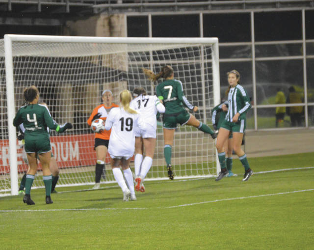 Ella Bianco (17) heads in a corner kick from teammate Kaileigh Nuessgen in the first half of Beavercreek's 4-2 state championship win in Division I girls soccer, Friday, Nov. 9 at MAPFRE Stadium in Columbus.