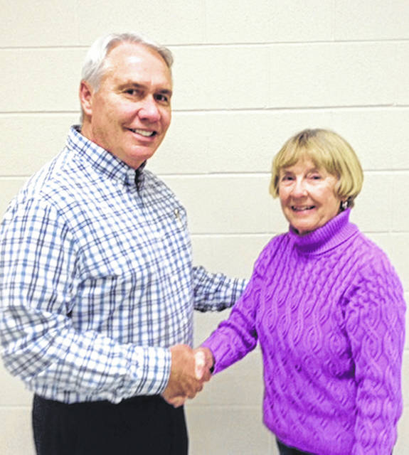 Submitted photo New Beavercreek Historical Society President Mark Wiley is welcomed by outgoing President Jill Kincer.