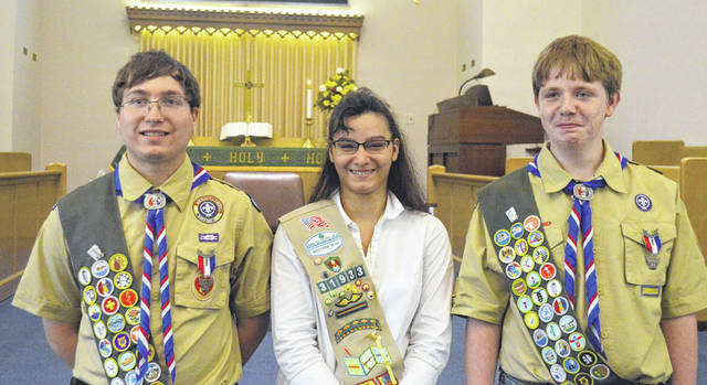 Submitted photo The Micheals siblings (left to right) Ben, Kera and Jason receive highest awards in scouting.