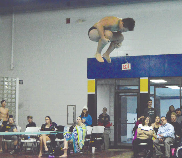 Beavercreek sophomore Anthony Johnston executes a tuck during a dive, Dec. 13 at a tri-meet between Beavercreek, Fairmont and host Centerville, at the Washington Township Recreation Center. Johnston finished second in the seven-diver boys field.
