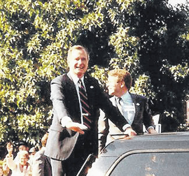 Vice President George H.W. Bush, during his 1988 campaign for president, visits Xenia with Congressman Mike DeWine. The two of them stood on a platform that extended from his car during the parade.