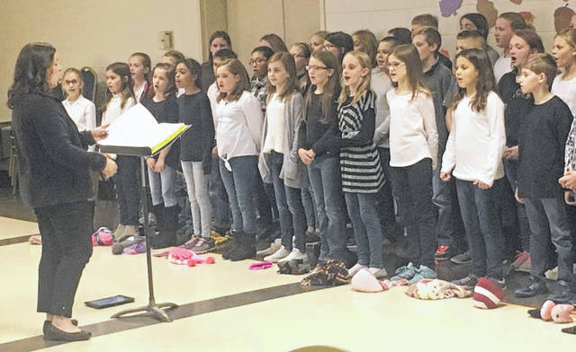 Fairbrook Elementary choir performed Christmas songs during the meeting.