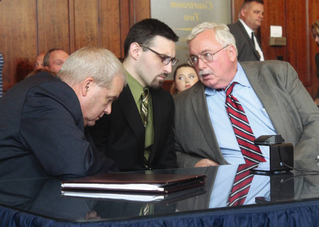 Bret Merrick, 25, center, listens to his attorneys during sentencing in Common Pleas Sept. 12. Defense Attorneys Michael Pentecost, left, and Dennis Lieberman represented him. The younger brother, who accompanied Dustin Merrick at the crime scene, pleaded guilty to involuntary manslaughter and was sentenced to 25 years in prison.