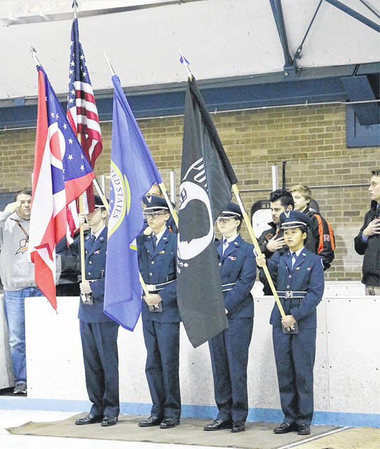 Submitted photos Beavercreek JROTC present the flags during the Military Appreciation Night hockey game. Pictured are Dylan O'Connor, Evan Meno, Maddie Long and Adelle Ngo.