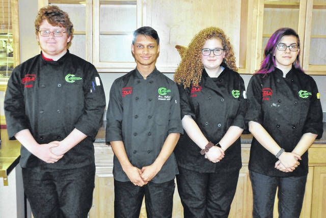 Photos courtesy GCCC Four Greene County Career Center culinary arts students earned medals at the Family, Career and Community Leaders of America (FCCLA) regional skills competition Feb. 16. The senior culinary team of (left to right) Joseph Stahl (Xenia), Ethan Gostel (Fairborn) and Alexandria Price (Xenia) earned a bronze medal. Junior Chloe Schroeder (Beavercreek) won a silver medal in the creative cake event. Chef Khalid Hamdy and teaching assistant Rosie Netherly serve as FCCLA advisors at Greene County Career Center.