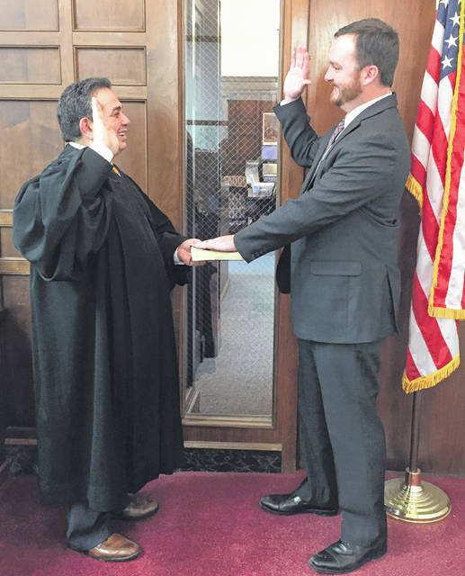 Submitted photo Kraig A. Hagler was sworn in recently as Greene County treasurer by Judge Adolfo Tornichio of the Greene County Common Pleas Court, Juvenile Division. Hagler was appointed by the Greene County Republican Central Committee to fill the unexpired term of Richard Gould, who is now serving as a Greene County Commissioner. A public swearing in ceremony will be held at a later date. Hagler's past financial experience includes management of the Key Bank branch in Xenia, and serving as a licensed investment advisor for Edward Jones in Beavercreek. He, his wife Christina, and their 19-month-old son, live in Xenia Township.