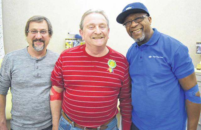 Submitted photo Russell Jenkins of Beavercreek turned 67 and made his 200th lifetime donation at the Dayton Community Blood Center. Jenkins (left) is pictured with Larry Jenkins and Robert Allen.