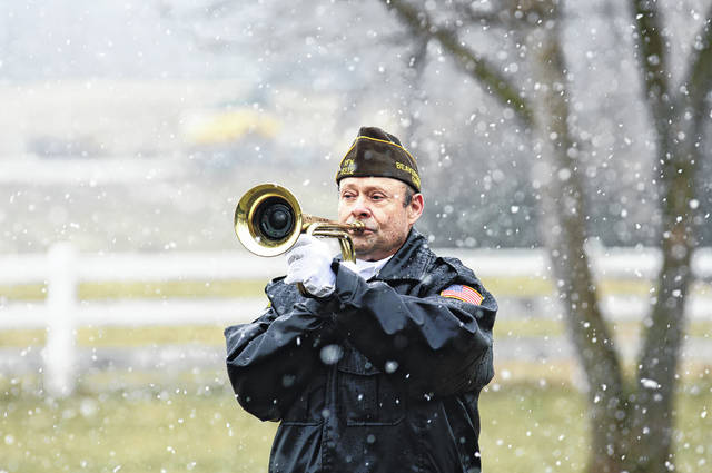 A member of VFW Beavercreek Memorial Post 8312 plays taps.