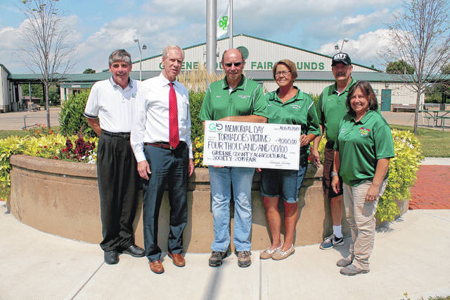 Anna Bolton | Greene County News Edward Marrinan, president of the board of directors of Greene Giving and Joe Harkleroad, Greene Giving board member, accept a $4,000 check from Dan Bullen, Agricultural Society president, and directors Amy Test, Mark Everman and Pat Zehring Aug. 19 at the fairgrounds. The funds will benefit local tornado relief efforts.