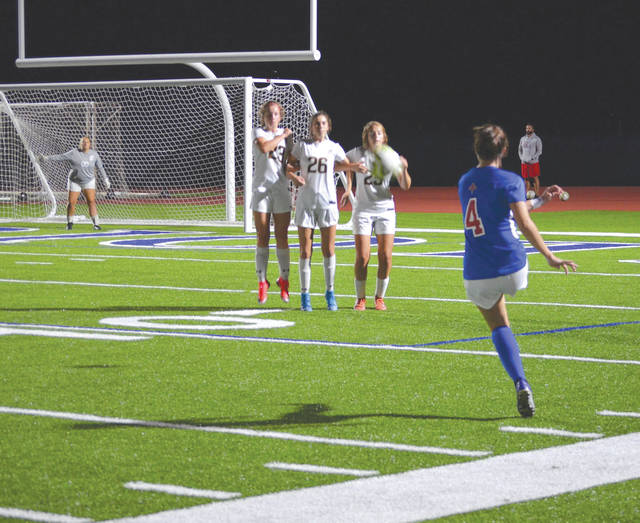 A Carroll player kicks a close-range direct kick, during Wednesday's Greater Catholic League Co-Ed girls varsity soccer match against visiting Cincinnati Roger Bacon, Oct. 8 in Riverside.