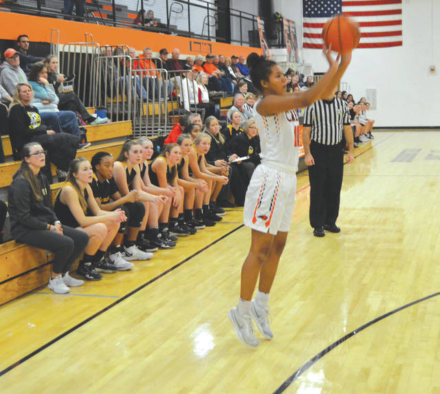 With the Centerville bench looking on, Beavercreek's Trinity Bean puts up a three-point shot Dec. 16 in the Ed Zink Fieldhouse in Beavercreek.