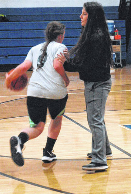 Morgan Minnich bumps a player as she drives to the basket during a drill.