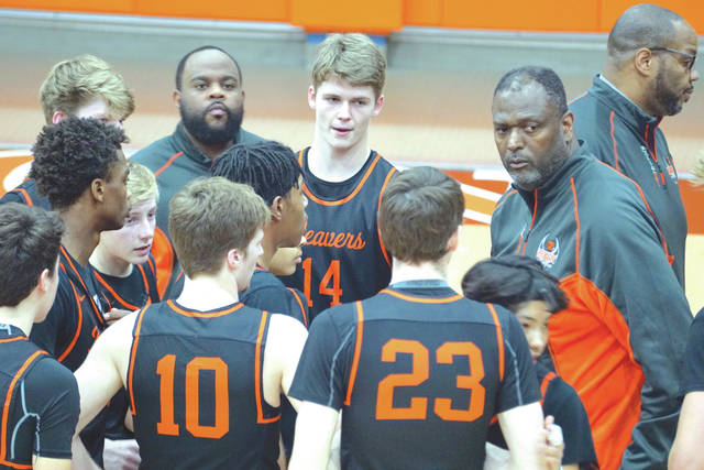 Beavercreek coach Steve Pittman (second from right) huddles his team together during a timeout, Jan. 14, in Wilmington.