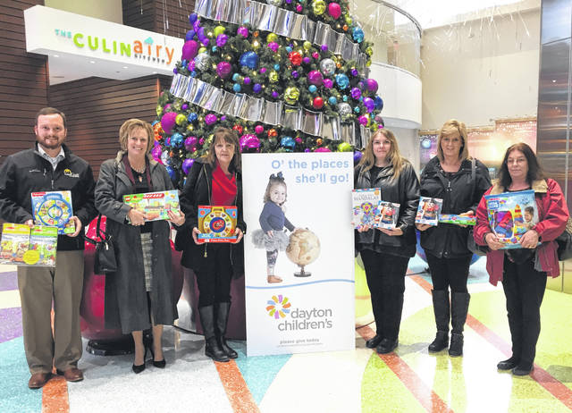 """Photo courtesy GC Treasurer The Greene County Treasurer's Office donates nearly $300 worth of toys to Dayton Children's Hospital Dec. 10. Staff members contribute to an office fund on a monthly basis and in December each year collectively decide what organization will receive the funds. After a recent visit to Dayton Children's with his 2-year-old son, Treasurer Kraig A. Hagler (left) noted that """"a toy given to him at that time helped to calm and distract him from what otherwise would have been a scary experience."""""""