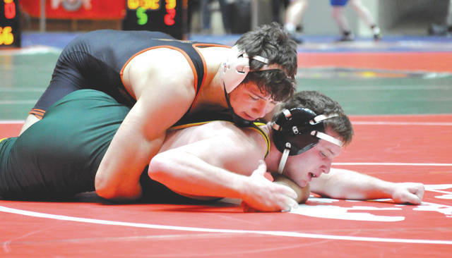 Senior 182-pounder Gavin Bell, of Beavercreek (top) recorded an 18-5 major decision over Lakewood St. Edward's Michael Garcar, during the OHSAA state wrestling dual team tournament, Feb. 16, in Columbus.