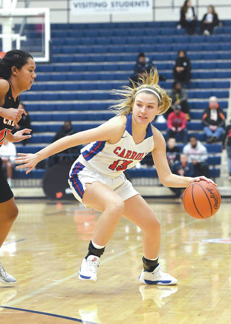 Senior guard Jillian Roberts (13) and the rest of the Carroll Patriots girls high school basketball team earned the No. 1 seeding in the Dayton area's Division II sectional tournament this season.