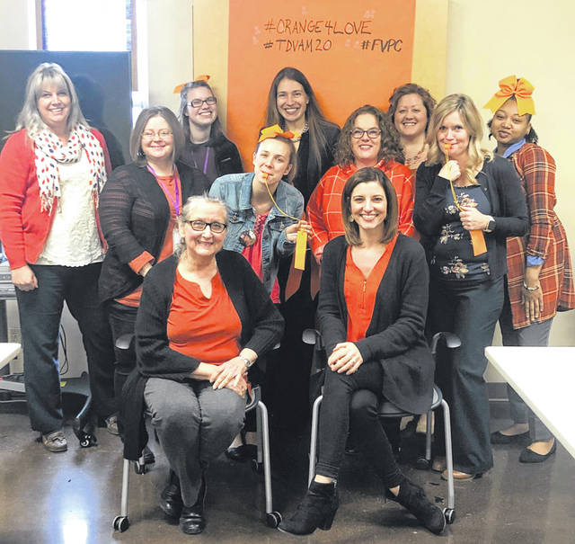 Photo courtesy FVPC Family Violence Prevention Center staff wears orange Feb. 11 for National Teen Dating Violence Awareness Month.