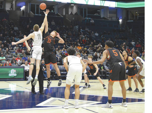 Beavercreek's Gabe Phillips (32) and Lakota East's Alex Mangold battle for the opening tipoff, in a March 8 Division I district championship contest at Xavier University's Cintas Center, in Cincinnati.