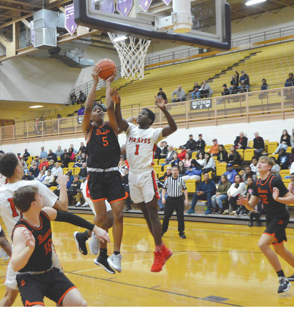 Beavers junior forward Siloam Baldwin (5) puts up a shot against Stanley Shivers of West Carrollton in the first half of Wednesday night's Division I sectional tournament game in Vandalia.