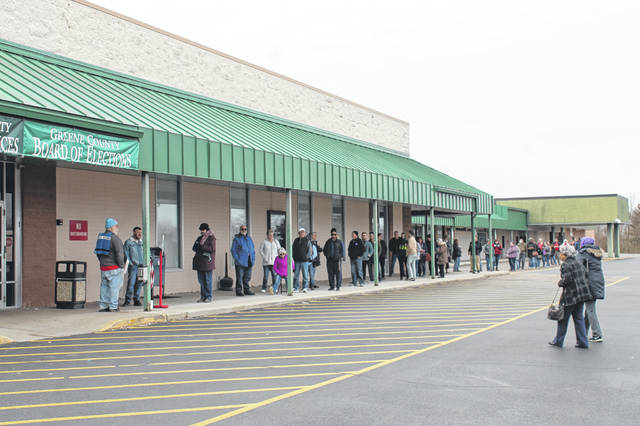 Anna Bolton | Greene County News About 50 people line up outside the Board of Elections around noon March 16 to vote early. A poll worker was directing voters inside one or two at a time so as to maintain distance between people in the building. Hand sanitizer was also provided inside.