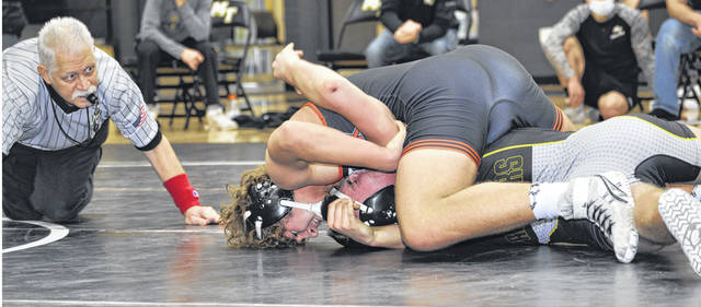 Photos by Karen Clark | For Greene County News The Beavercreek High School wrestling team visited Miami Trace for a dual meet over the weekend. Miami Trace won, 50-27. Pictured, Beavercreek's Austin Papalios pinned Kylan Knapp in 1:17 at 170 pounds.