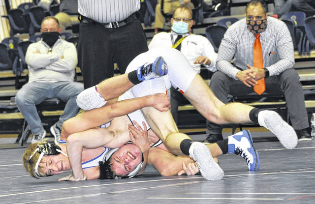 Photos by Karen Clark | For Greene County News Hayden Randolph of Beavercreek was the 152-pound champion at the Greater Western Ohio Conference meet. While it appears Miamisburg's Matt Barga has the advantage, Randolph won, 5 - 3, to win the title.