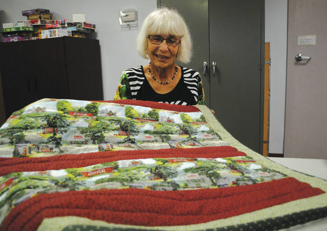 """Janet Reuwer created a full-sized Coca-Cola quilt two weeks ago because it is """"nostalgic"""" and """"makes her feel good,"""" she said. Reuwer creates quilts that she said she later gives away to local nursing homes."""