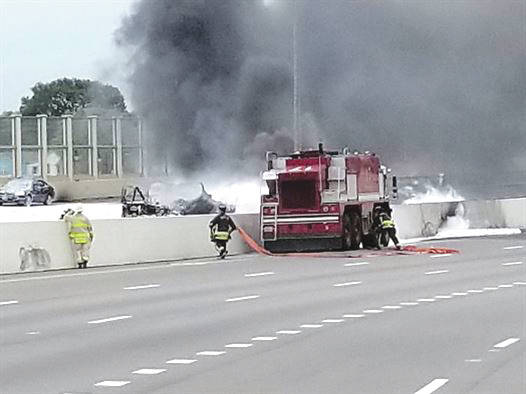 Submitted photo Wright-Patterson Air Force Base fire fighters assist Dayton first responders as they battle a major fuel fire on I-75 April 30 in Dayton. After using foam to combat the fire from the ARFF crash vehicle, Wright-Patterson fire fighters passed hoses to Dayton fire fighters to extinguish the remaining fire.