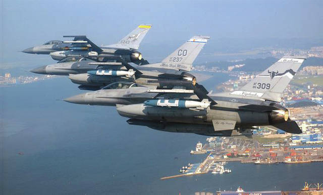 Submitted photo A three-ship formation of Air National Guard F-16 Fighting Falcons flies over Kunsan City, South Korea. The F-16s are from New Mexico, Colorado and Montana.