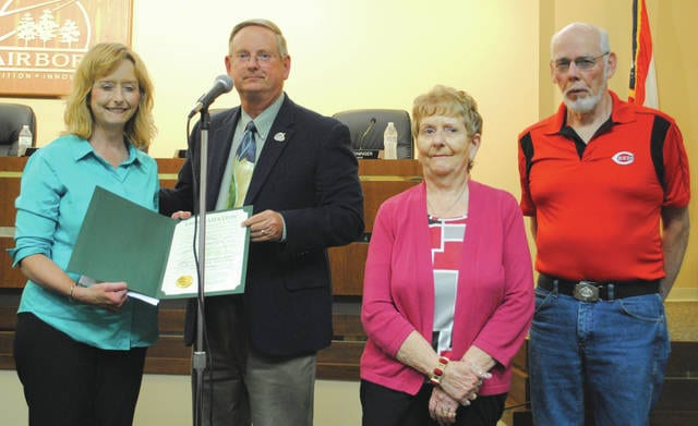 Whitney Vickers | Greene County News City Manager Secretary Penny Davis, Fairborn Mayor Dan Kirkpatrick and Davis's parents were present to accept the proclamation that declared June as Scleroderma Awareness Month across the City of Fairborn.