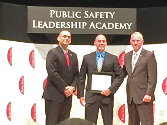 Submitted photo Fairborn Police Department Sgt. Ben Roman is pictured in the middle with Colonel Paul Pride (on the right) of the Ohio State Highway Patrol, the highest ranking member of the OSHP; and Lieutenant Angel Burgos (on the left) of the Ohio State Highway Patrol, prior Public Safety Leadership Academy class speaker.