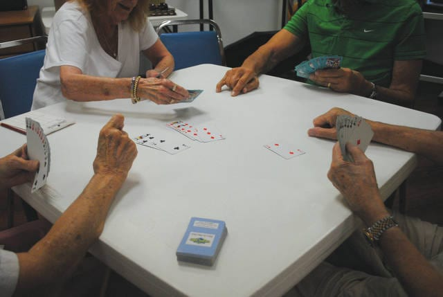 Whitney Vickers | Fairborn Herald The Fairborn Senior Center hosts weekly bridge games, inviting members to pull up a chair and play. Pictured players include Jean and Chuck Fada as well as Marge and Ken Lawson.
