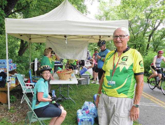 Trail Sentinel Bob Young volunteered at one of the many rest stops — featuring cold drinks, snacks and fresh fruit — along the ride.