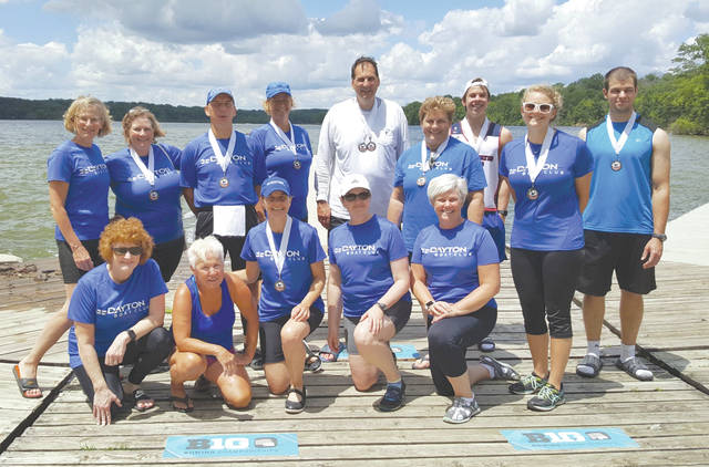 Members of the Dayton Rowing Club who participated in the Indy Sprints rowing competition, June 24 at Eagle Creek Park in Indianapolis. Front — Marion Stout, Becky Rounds, Maureen Schlangen, Jennifer Speed, Vicki Schwab. Back — Anne Athmer, Jane Wittmann, Vince Leopold, Amy O'Connor, Pete Hoshor, Susan Federinko, Andy Walczak, Julie Wittmann, Marty Carrabine.